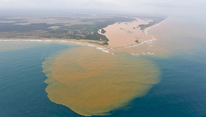 Sludge from a tailings pond burst many miles upstream on the Rio Doce River in Brazil reaches the Atlantic Ocean.