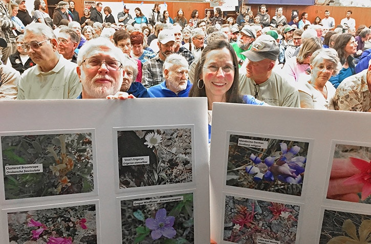 Withdrawal supporters show off photos or rare wildflowers