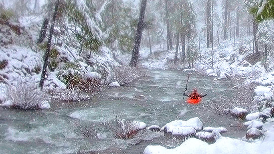 Zach Collier (behind the camera) and J.R. Wier (kayak) exploring the South Fork of Rough and Ready Creek 12/20/2013 (NW Rafting Co. photo)